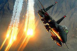 Airplane Pictures - An F-15E Strike Eagle from the 391st Expeditionary Fighter Squadron at Bagram Air Base, Afghanistan, launches heat decoys during a close-air-support mission over Afghanistan, 15 December 2008