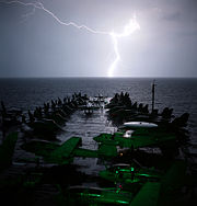Airplane Pictures - USS Abraham Lincoln rides out a storm in the Arabian Sea while on station in support of Operation Southern Watch and Operation Enduring Freedom.