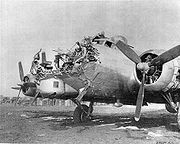 Airplane Pictures - B-17G-80BO 43-38172 8th AF 398th BG 601st BS damaged on bombing mission over Cologne, Germany on 15 October 1944. Pilot 1st Lt. Lawrence De Lancey brought the wounded Fortress back to Nuthampstead, UK, where photo was taken. Notice the upwards effect of the anti-aircraft shell; the bombardier S/Sgt. George E. Abbott was killed.