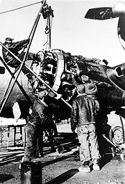 Airplane Pictures - Nuthampstead, England. Aircraft mechanics with the 398th Bombardment Group change a B-17 Flying Fortress engine. During the group's stay in England from May 1944 to April 1945, the 398th flew 195 missions and lost 292 men and 70 B-17 aircraft in combat