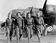 Airplane Pictures - Four women pilots leaving their ship, Pistol Packin' Mama, at the four-engine school at Lockbourne AAF, Ohio, during WASP training to ferry B-17 Flying Fortresses. L to R are Frances Green, Marget (Peg) Kirchner, Ann Waldner and Blanche Osborn