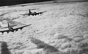 Airplane Pictures - Boeing B-17F bombing through overcast - Bremen, Germany, on 13 Nov. 1943