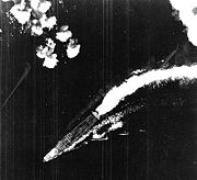 B-17 attack misses Hiryū; this was taken some time between 0800-0830. A Shotai of three Zeros is lined up near the bridge. This was one of several CAPs (Combat Air Patrols) launched during the day