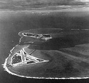 Midway Atoll, several months before the battle. Eastern Island (with the airfield) is in the foreground, and the larger Sand Island is in the background to the west