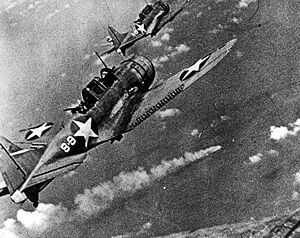 U.S. Douglas SBD-3 Dauntless dive bombers about to attack the burning cruiser Mikuma for the third time