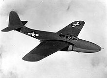 Airplane Picture - Bell YP-59A in flight. X and Y aircraft had rounded vertical stabilizers and wingtips while the production A and B models had squared surfaces. The YP-59A can be distinguished from the XP-59A because Ys had nose armament.