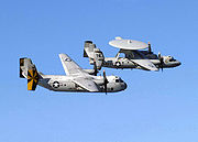 Airplane Pictures - A C-2A Greyhound and an E-2C Hawkeye from the USS Abraham Lincoln (CVN-72) in 2005.