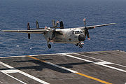 Airplane Pictures - A C-2A lands on the flight deck of USS Kitty Hawk (CV-63) in the western Pacific Ocean.