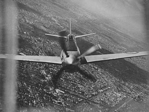 The CA-15 piloted by Flt Lt J.A.L. Archer. Photographed from the rear turret of a Lincoln bomber over Melbourne
