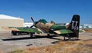 Douglas Skyraider parked at airport ramp.