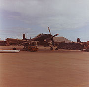 Warbird picture - A-1 Skyraider of the VNAF 520th Fighter Squadron being loaded with napalm at Danang AB in 1967.