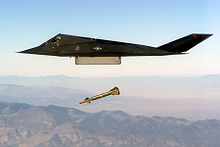 Airplane Picture - An F-117 conducts a live exercise bombing run using GBU-27 laser-guided bombs.