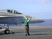 Airplane Pictures - FA-18 attached to catapult on the flight deck of USS Abraham Lincoln