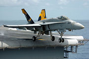 Airplane Pictures - An FA-18 taking off from USS Kitty Hawk.