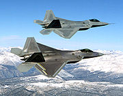 Airplane Pictures - Two F-22s during flight testing, the upper one being the first EMD F-22, Raptor 01