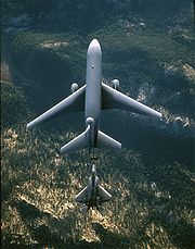 Airplane Pictures - A KC-10 Extender (top) refuels an F-22 Raptor