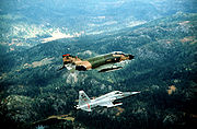 Airplane picture - New Jersey Air National Guard F-4 Phantom II aircraft flying in close formation with a Norwegian Air Force F-5A Freedom Fighter aircraft during an exercise in 1982