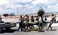 A Portuguese F-84 being loaded with ordnance in the 1960s, at Luanda Air Base, during the Portuguese Colonial War.