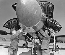 Airplane Picture - F-94C being armed with 2.75 in (70 mm) FFARs