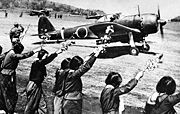 Airplane Pictures - A Nakajima Ki-43 III-Ko Oscar sets off from a Japanese airfield on a kamikaze mission in the Okinawa area on 12 April 1945 as high school girls wave farewell