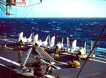 4 FJ-3 Fury fighter-bombers of VF-33 and an AD-6 of VA-25 on the deck of the USS Intrepid in the North Atlantic in 1957