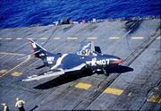 Warbird picture - An F9F-6 of VF-24 on the USS Essex in 1955