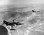 Warbird picture - Airplane picture - Two F9F-2Bs of VF-721 over Korea.
