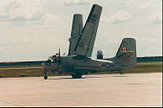 Canadian Forces CP-121 Tracker from VU-33 folds its wings while taxiing at CFB Moose Jaw in 1982