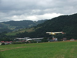 Airplane Picture - Polish civilian Yak-12M taking off towing a glider