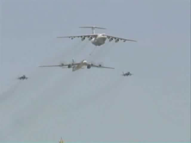 Airplane Picture - A Tu-95 performs a fly-over with an Il-78 and two MiG 29s simulating aerial refueling at the Victory Day Parade in Moscow on 9 May 2008.