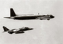 Airplane Picture - A Royal Air Force of Oman Jaguar S(O) intercepting an IL-38 in 1987.