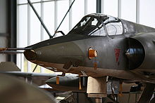Airplane Picture - Nose of a Mirage IIIR: thinner than the fighter version, this nose has several glass apertures for medium-format cameras.