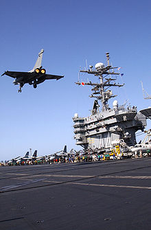 Airplane Picture - A Rafale M flies above the aircraft carrier USS John C. Stennis.