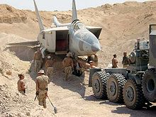 Airplane Picture - Iraqi MiG-25 found buried under the sand at Al Taqaddum Airbase, Iraq. 29 February 2004