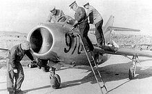 Airplane Picture - Soviet groundcrew prepare a MiG-15bis from Antung airbase,China, mid-1952