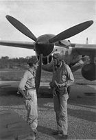 Airplane Pictures - (L-R) Thomas B. McGuire and Charles Lindbergh discussing a mission on Bial Island in July 1944