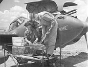 Airplane Pictures - Pilot and aircraft armorer inspect ammunition for the central 20 mm cannon