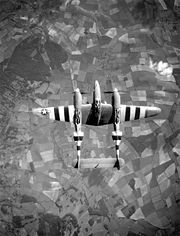Airplane Pictures - P-38 participating in the Normandy campaign as evidenced by the D-Day invasion stripes