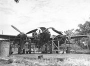 Airplane Pictures - Ground crew members of the 459th Fighter Squadron, nicknamed the Twin Dragon Squadron', working on a Lockheed P-38 at an air base in Chittagong, India - January 1945