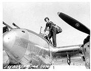 Airplane Pictures - Ruth Dailey, WASP climbs into a P-38
