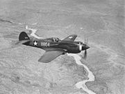 Airplane Pictures - A three-quarter view of a P-40B, X-804 (39-184) in flight. This aircraft served with an advanced training unit at Luke Field, Arizona