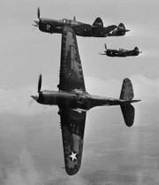Airplane Pictures - In the vicinity of Moore Field, Texas. The lead ship in a formation of P-40s is peeling off for the attack in a practice flight at the Army Air Forces advanced flying school. Selected aviation cadets were given transition training in these fighters before receiving their pilot's wings, 1943