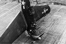 Warbird Picture - An SB2C Helldiver failed to catch the wire on landing and hit the first barrier, nose-diving into the deck (USS Hornet, 3 July 1944).