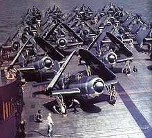 Warbird Picture - SB2Cs in tricolor scheme (front) on the flight deck of USS Yorktown in 1943.