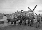Airplane Pictures - Pilots of 611 West Lancashire Squadron lend a hand pushing an early Spitfire Mark IXb, Biggin Hill, late 1942