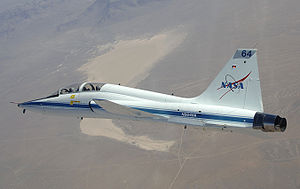 Airplane picture - NASA Dryden's T-38 trainer aircraft in flight over Cuddeback Dry Lake in Southern California