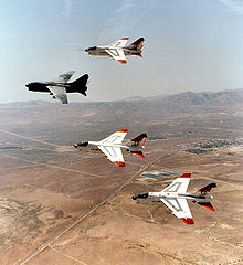 Airplane Picture - Prototype YA-7Ds 67-14582 and 67-14584, along with 69-6191 and 69-6217 making last flyover retirement formation over Edwards AFB, California, heading to AMARC, August 1992