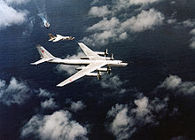 Airplane Picture - An F-8 of USS Oriskany intercepts a Tu-95 'Bear-B'.