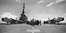 Airplane Picture - Two Crusaders prepare to launch from USS Midway; their variable-incidence wings are in the