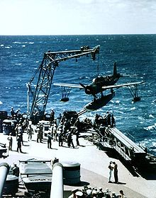 Warbird Picture - USS Missouri recovers a Vought OS2U Kingfisher during her 1944 shakedown cruise. Note the catapult below the plane, which was used to launch the planes off the battleship.